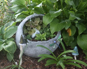 Concrete sphere with hostas